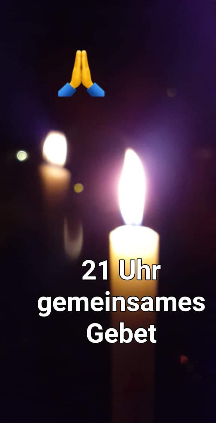 """""""Fördefrau"""" ermuntert mit ihrem Kerzenbild zum gemeinsamen Gebet"""